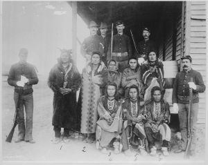 Eight_Crow_prisoners_under_guard_at_Crow_agency,_Montana,_1887_-_NARA_-_531126