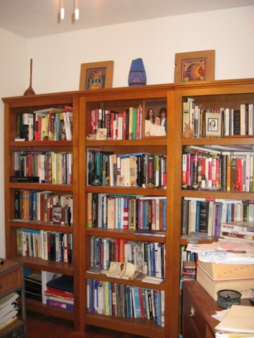 Three of the eleven bookcases scattered about my tiny house – the legacy of growing up in a house without books and the inability to return borrowed books to libraries on time.